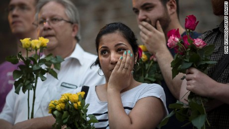 LONDON, ENGLAND - JUNE 19:  A woman reacts as she attends a vigil near the Finsbury Park Mosque on June 19, 2017 in London, England. Worshippers were struck by a hired van as they were leaving Finsbury Park mosque in North London after Ramadan prayers. One person was killed in the terror attack with a further 10 people injured.  (Photo by Dan Kitwood/Getty Images)