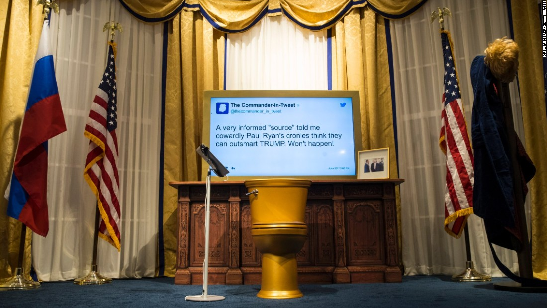 A golden toilet sat in an Oval Office replica where guests were able to sit and send tweets.