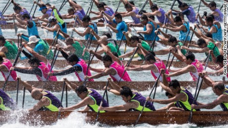 TOPSHOT - Competitors take part in a dragon boat race in Hong Kong on May 14, 2017.  The races are part of a multi-million dollar programme of events organised to celebrate Hong Kong's 20th handover anniversary from Britain to China which falls on July 1.  / AFP PHOTO / DALE DE LA REY        (Photo credit should read DALE DE LA REY/AFP/Getty Images)