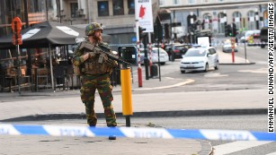 A soldier secures an area outside Brussels Central Station.