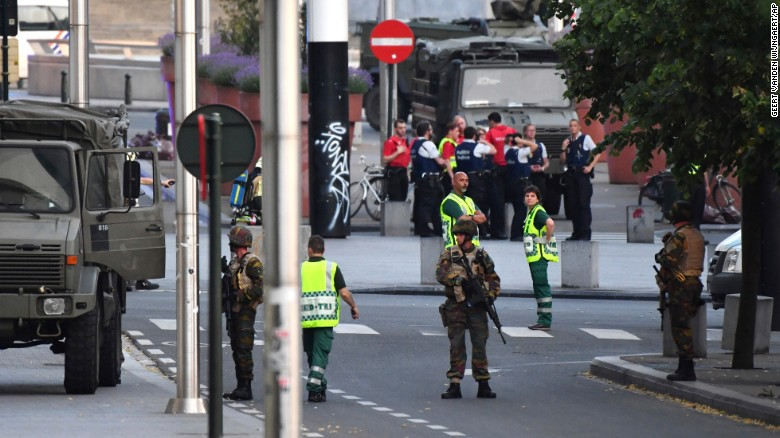Belgian Army soldiers and police patrol Brussels Central Station after a reports of explosions
