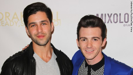"Actor Josh Peck, left, and Drake Bell attend Drake Bell's album release party for ""Ready Steady Go!"" at Mixology101 & Planet Dailies on April 17, 2014, in Los Angeles, California."