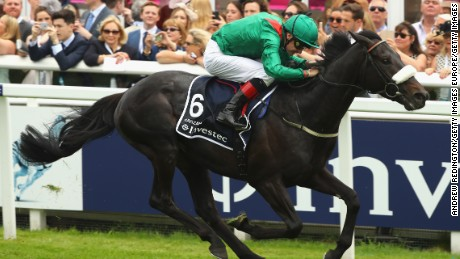 EPSOM, ENGLAND - JUNE 04:  Number Six, Harzand  wins the Investec Epsom Derby at Epsom Racecourse on June 4, 2016 in Epsom, England.  (Photo by Andrew Redington/Getty Images)