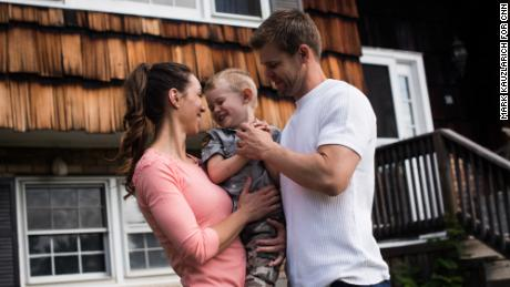 Nicole and Christian McDonald with their 3-year-old son, Aza, outside the family's new home in upstate New York.