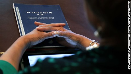 WASHINGTON, DC - MARCH 22:  (AFP OUT) Congressional Black Caucus Executive Committee member Rep. Brenda Lawrence (D-MI) has a copy of a report titled 'We Have A Lot To Lose' during a meeting with U.S. President Donald Trump in the Cabinet Room at the White House March 22, 2017 in Washington, DC.
