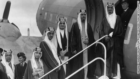 31st August 1945:  Five sons of King Abdul Aziz Ibn Saud of Saudi Arabia board a plane at Herne Airport in Hampshire. They are the Amir Faisal (later King Faisal), Amir Mohammed, Amir Fahd (later King Fahd), Amir Abdullah Al Faisal and Amir Nawaf. On the left is the Saudi Ambassador in London.  (Photo by William Vanderson/Fox Photos/Getty Images)
