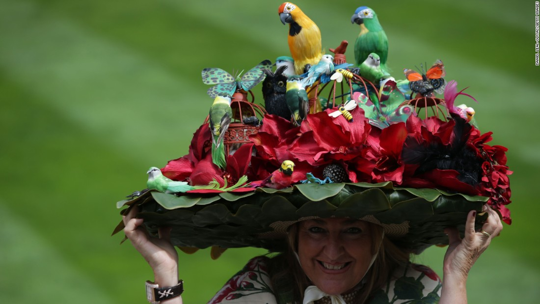 A little birdie told us that this is a picture of Paula Gibson from Argentina, who poses with her floral hat as she attends the third day of the five-day meeting.