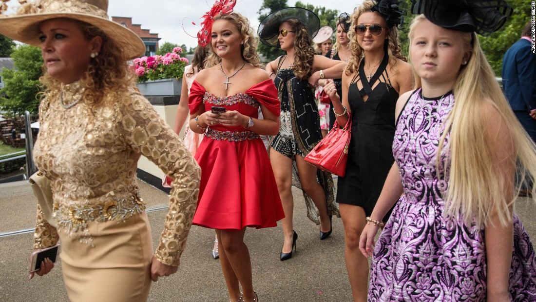Racegoers arrive on day 3 of Royal Ascot at Ascot Racecourse on June 22, 2017 in Ascot, England. The five-day Royal Ascot meeting is one of the highlights of the horse racing calendar and has been held at the famous Berkshire course since 1711.