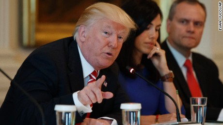 "President Donald Trump speaks during the ""American Leadership in Emerging Technology"" event in the East Room of the White House, Thursday, June 22, 2017, in Washington. From left, Trump, Trumbull Unmanned CEO Dyan Gibbens, and Honeywell CEO Darius Adamczyk. (AP Photo/Evan Vucci)"