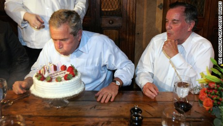 Chicago, UNITED STATES:  US President George W. Bush (L) blows out the candles on his birthday cake beside Chicago Mayor Richard M. Daley during a private dinner party at the Chicago Firehouse Restaurant 06 July 2006 in Chicago, Illinois.    AFP PHOTO / TIM SLOAN  (Photo credit should read TIM SLOAN/AFP/Getty Images)