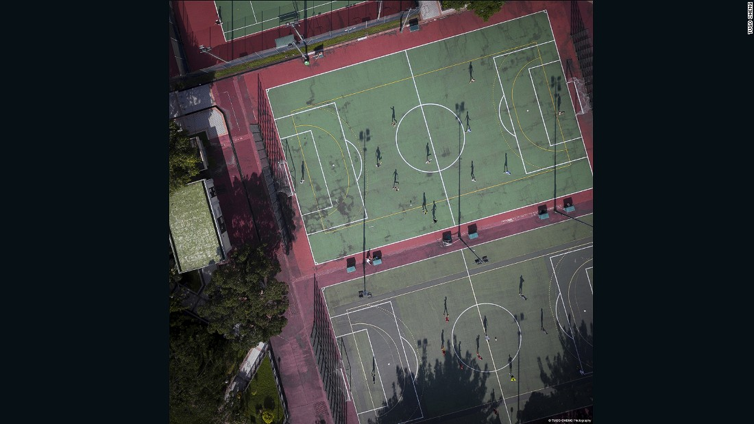 Footballers play in Shatin sports ground in Hong Kong's New Territories.