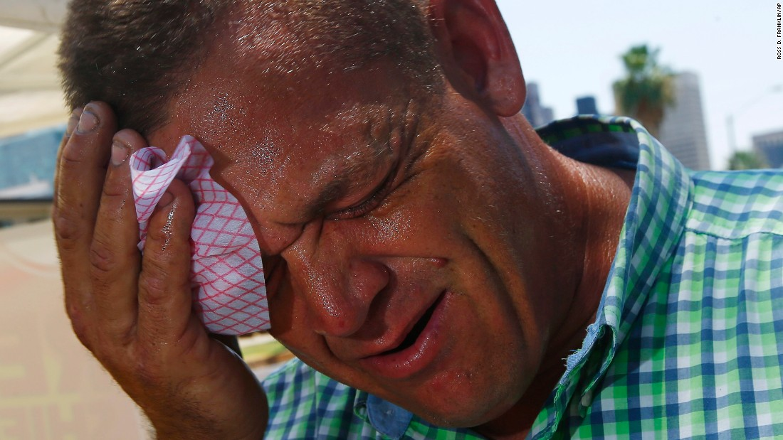 "Steve Smith wipes sweat from his face as temperatures climb to near-record highs in Phoenix on Monday, June 19. <a href=""http://www.cnn.com/2017/06/20/us/gallery/western-heat-wave/index.html"" target=""_blank"">A punishing heat wave</a> is breaking records in parts of the western United States, causing massive power outages and flight cancellations."