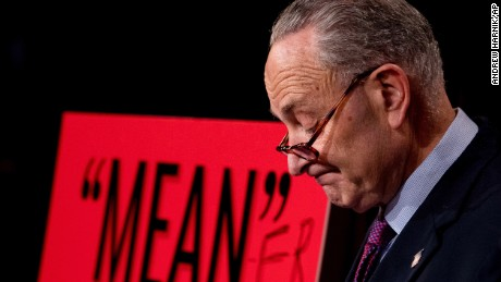 "Senate Minority Leader Chuck Schumer, D-N.Y., pauses after writing ""Mean-er"" on a reported quote by President Donald Trump as Schumer responds to the release of the Republicans' healthcare bill which represents the long-awaited attempt to scuttle much of President Barack Obama's Affordable Care Act, at the Capitol in Washington, Thursday, June 22, 2017."