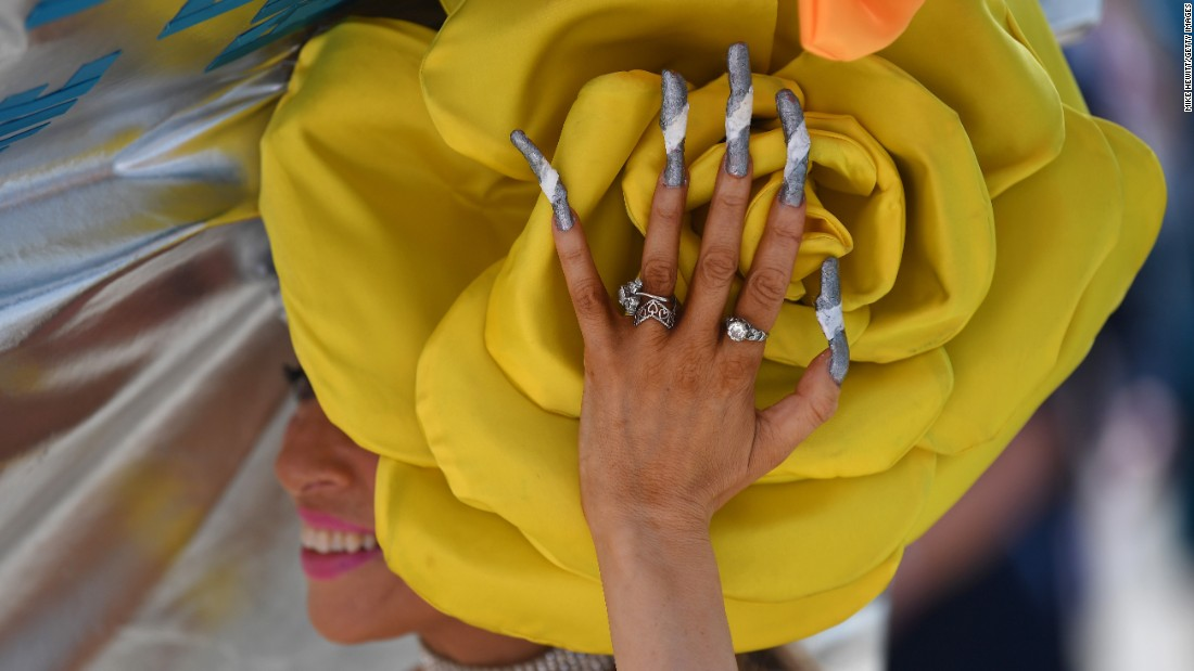 "A woman wears an extravagant hat during <a href=""http://www.cnn.com/2017/06/22/sport/gallery/royal-ascot-2017-ladies-day/"" target=""_blank"">Royal Ascot,</a> the most prestigious event in the British horseracing calendar, on Thursday, June 22. It was Ladies Day."