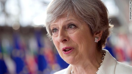 British Prime Minister Theresa May speaks with the media as she arrives for an EU summit at the Europa building in Brussels on Friday, June 23, 2017. European Union leaders meet in Brussels on the final day of their two-day summit to focus on ways to stop migrants crossing the Mediterranean and how to uphold free trade while preventing dumping on Europe's markets. (AP Photo/Virginia Mayo)