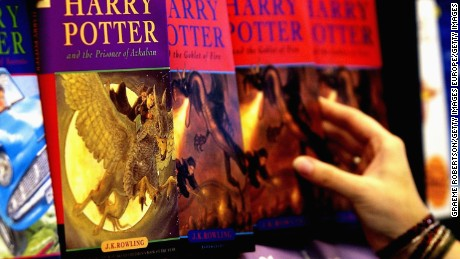 LONDON- JUNE 16:  A woman looks at some of J.K Rowlings Harry Potter books in waterstones book store on  June 16, 2003 inLondon. Countdown to the launch of the 5th Harry Potter book begins. (Photo by Graeme Robertson/Getty Images)
