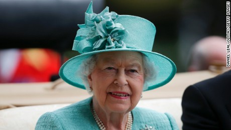 Britain's Queen Elizabeth II  arrives by carriage on the fourth day of the Royal Ascot horse racing meet, in Ascot, west of London, on June 23.