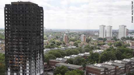 The burnt Grenfell Tower apartment building stands testament to the recent fire in London, Friday, June 23, 2017.  British officials have ordered an immediate examination Friday, into a fridge-freezer that is deemed to have started the fire in the 24-storey high-rise apartment building early morning of June 14th, and the outside cladding of the building which is thought to have helped spread the fire, according to police, leaving dozens dead.(AP Photo/Frank Augstein)