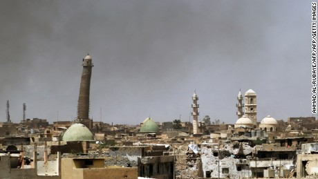 TOPSHOT - A general view shows a leaning minaret and Nouri Mosque in the Old City of Mosul on May 24, 2017, during the ongoing offensive to retake the area from Islamic State (IS) group fighters. / AFP PHOTO / Ahmad al-Rubaye        (Photo credit should read AHMAD AL-RUBAYE/AFP/Getty Images)
