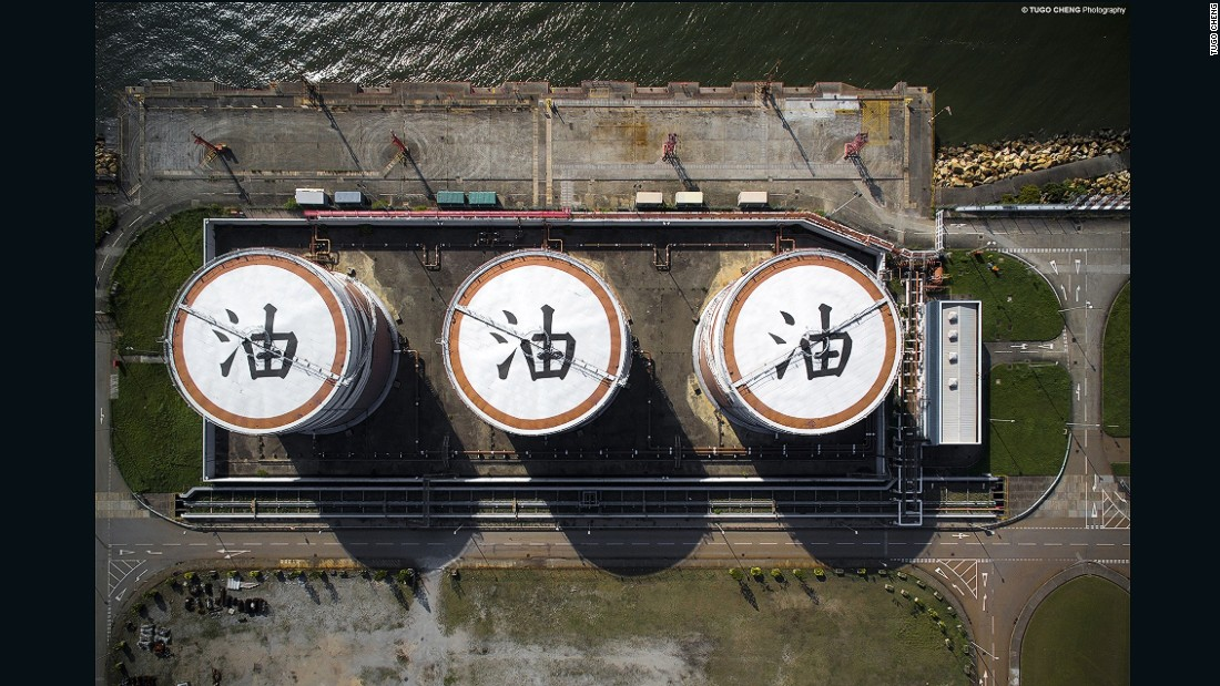 "In the northwest of Hong Kong, oil storage tanks at power stations are painted with huge Chinese characters that represent the word ""oil""."