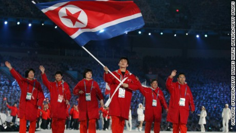 VANCOUVER, BC - FEBRUARY 12:  Song Chol Ri of North Korea carries the national flag during the Opening Ceremony of the 2010 Vancouver Winter Olympics at BC Place on February 12, 2010 in Vancouver, Canada.  (Photo by Cameron Spencer/Getty Images)