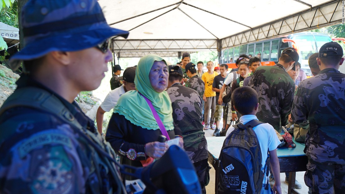 Many of the thousands of people who pass through the checkpoints each day are former residents of Marawi.