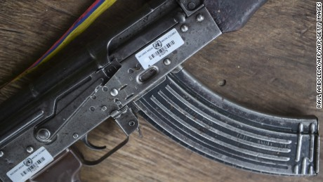 View of a weapon bearing a UN label, at the entrance to the Transitional Standardization Zone Jaime Pardo Leal in Colinas, Guaviare  department, Colombia on June 14, 2017. Colombia's FARC rebels handed some weapons earlier this month, in what were described as meaningful strides toward a deadline for a total surrender of arms next June 20th. / AFP PHOTO / RAUL ARBOLEDA        (Photo credit should read RAUL ARBOLEDA/AFP/Getty Images)