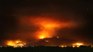 The Frye Fire burns the western edge of the Pinaleño Mountains in Coronado National Forest above Ft. Grant Prison near Willcox, Ariz. on Thursday, June 22, 2017. The lightning-caused fire is now at nearly 29,000 acres. More than 800 personnel are assigned to the fire. (Kelly Presnell /Arizona Daily Star via AP)
