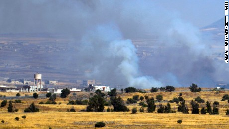 A picture taken from the Israeli-occupied Golan Heights shows smoke billowing from the Syrian side of the border on June 24, 2017.