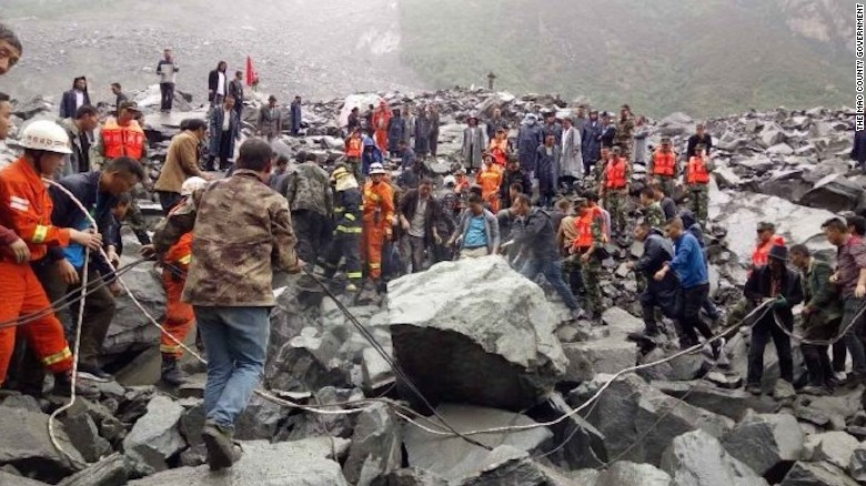 100 people feared buried by China landslide