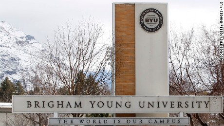 PROVO, UT- MARCH 1: Students walks past the entrance of Brigham Young University on March 1, 2012 in Provo, Utah. BYU is the alma mater of Republican U.S. presidential candidate Mitt Romney. (Photo by George Frey/Getty Images)