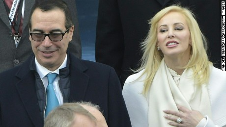 Donald Trump's Treasury nominee Steven Mnuchin (C-L) and his wife Louise Linton are greeted upon arrival on the platform of the US Capitol in Washington, DC, on January 20, 2017, before the swearing-in ceremony of US President-elect Donald Trump. / AFP / Mandel NGAN        (Photo credit should read MANDEL NGAN/AFP/Getty Images)