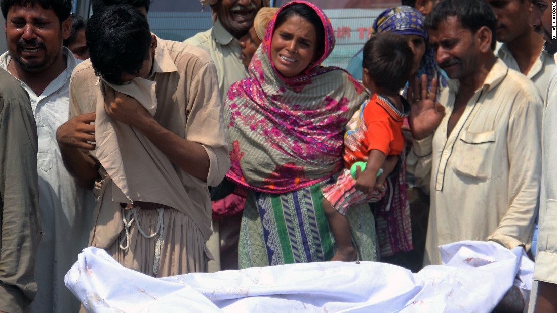 A victim of the blast is brought to a hospital in Bahawalpur.