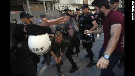 Riot police detain LGBTQ supporters in Istanbul.