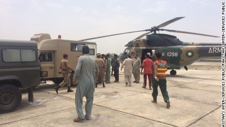 Military helicopters evacuate victims of oil tanker explosion in Pakistan.