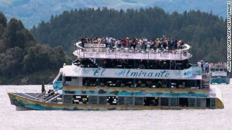 Passengers are seen on the tourist boat Almirante on Sunday. The boat sank near the town of Guatape.
