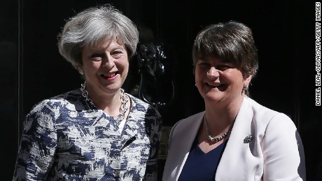 Britain's Prime Minister Theresa May (L) poses for a picture with Democratic Unionist Party (DUP) leader Arlene Foster at 10 Downing Street in central London on June 26, 2017. / AFP PHOTO / Daniel LEAL-OLIVAS        (Photo credit should read DANIEL LEAL-OLIVAS/AFP/Getty Images)