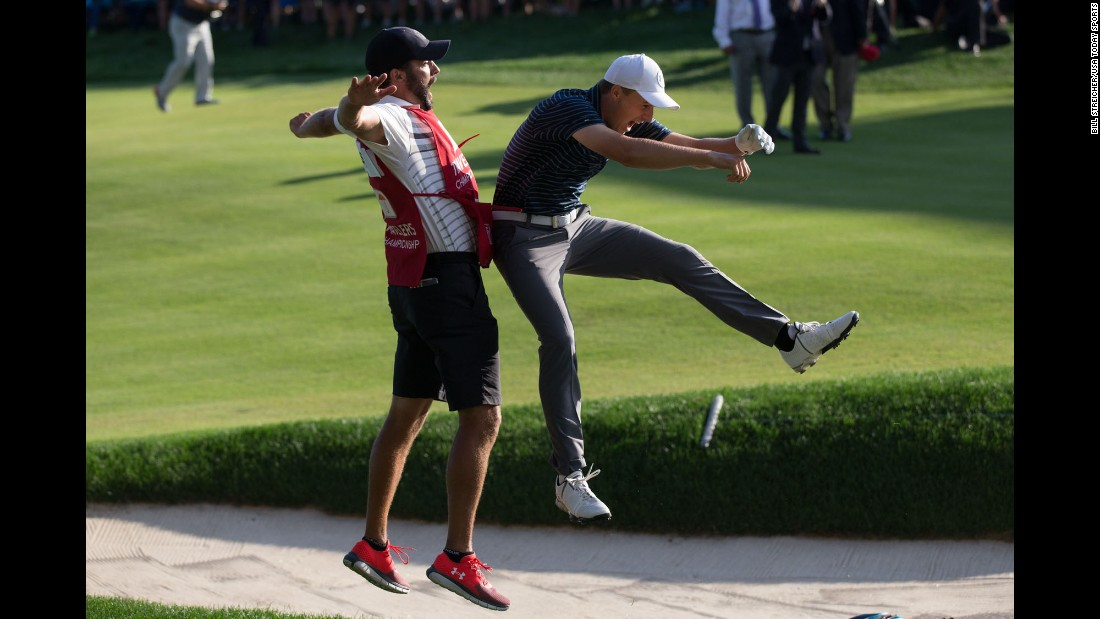 Jordan Spieth celebrates with his caddie, Michael Greller, after holing a bunker shot to win the Travelers Championship on Sunday, June 25. The shot came on the first playoff hole against Daniel Berger.