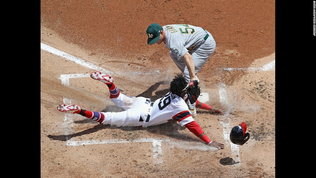 Oakland pitcher Sonny Gray tags out Alen Henson of the Chicago White Sox during a Major League Baseball game on Sunday, June 25.