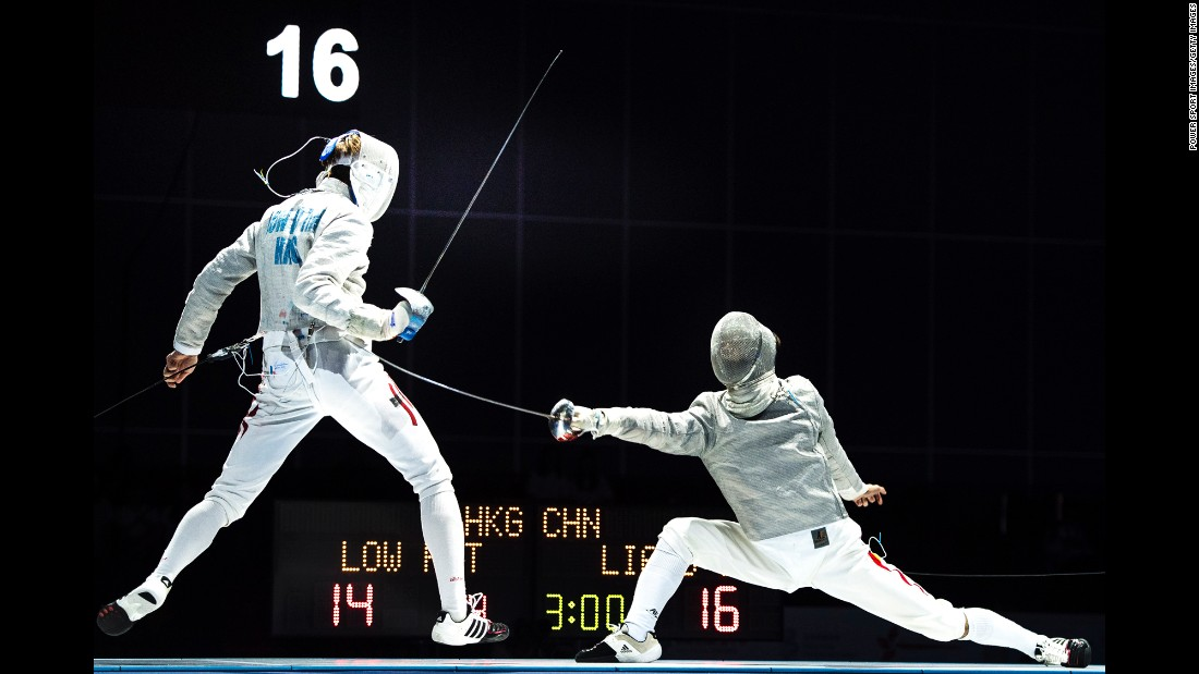 China's Jianhao Liang, right, competes against Hong Kong's Ho Tin Low during the Asian Fencing Championships on Tuesday, June 20.