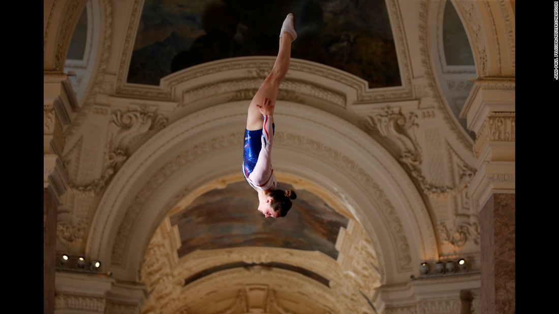 A gymnast performs on a trampoline at the Petit Palais, a museum in Paris, on Friday, June 23. There were sporting events across Paris to promote the city's bid for the 2024 Olympics.