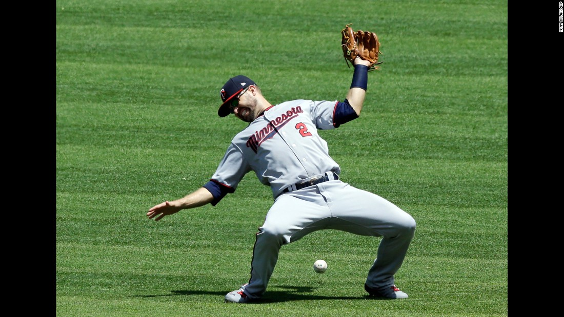 Minnesota second baseman Brian Dozier can't come up with a catch during a Major League game in Cleveland on Sunday, June 25.