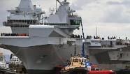 Massive new aircraft carrier pushes from dock