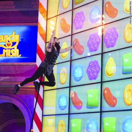 "A contestant competes on CBS's ""Candy Crush."""