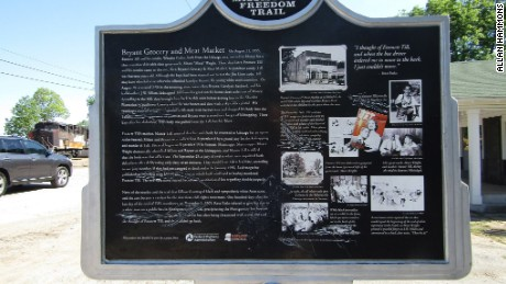 Scratches mar a historical marker outside the grocery store where Emmett Till is said to have whistled at a white woman.
