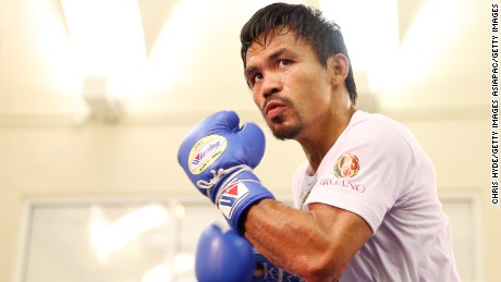 MACAU - NOVEMBER 20:  Manny Pacquiao trains during a workout session at The Venetian on November 20, 2014 in Macau, Macau.  (Photo by Chris Hyde/Getty Images)
