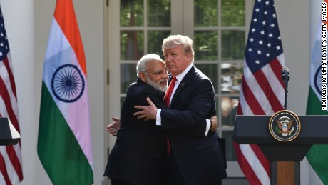 US President Donald Trump and Indian Prime Minister Narendra Modi embrace in the Rose Garden during a joint press conference  at the White House in Washington, DC, June 26, 2017. / AFP PHOTO / Nicholas Kamm        (Photo credit should read NICHOLAS KAMM/AFP/Getty Images)