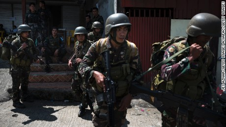 Soldiers being deployed to the front lines of Marawi are transported to safety on June 3, 2017, over a week after the siege began.