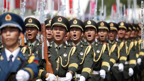 "China's Peoples' Liberation Army (PLA) soldiers march at the Ngong Shuen Chau Barracks in Hong Kong on July 1, 2015, to mark the 18th anniversary of Hong Kong's handover from Britain to China. July 1 is traditionally a day of protest in Hong Kong and also marks the anniversary of the handover from Britain to China in 1997, under a ""one country, two systems"" agreement. AFP PHOTO / ISAAC LAWRENCE        (Photo credit should read Isaac Lawrence/AFP/Getty Images)"
