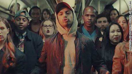 "Riz MC in a scene from the video for ""Immigrants (We Get the Job Done)"" from ""The Hamilton Mixtape."""